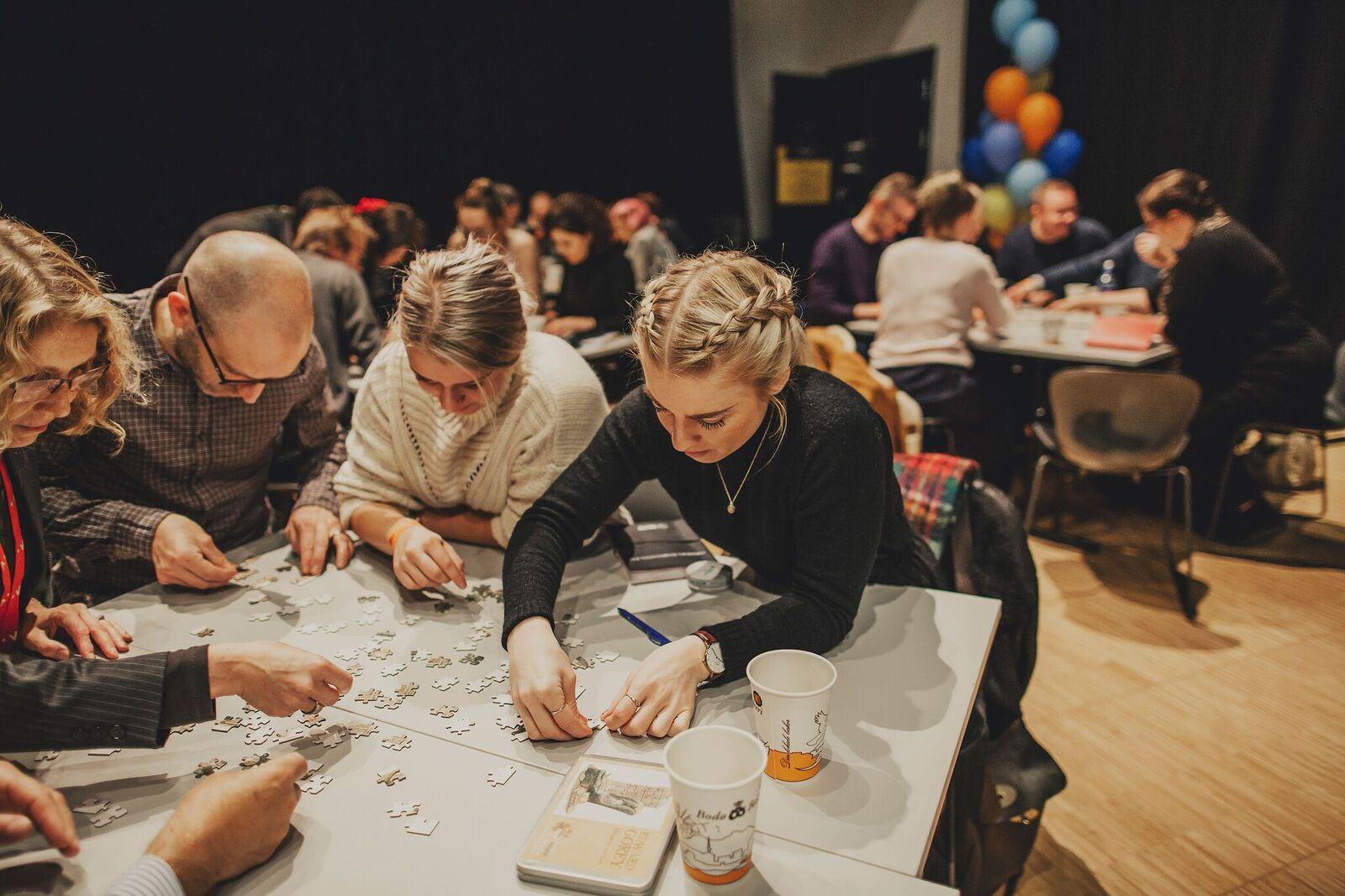 Educators solving a puzzle during workshop